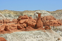 Red toadstool and red rocks