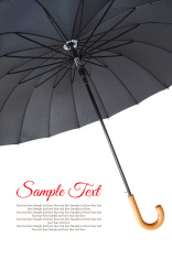 Open large black umbrella from inside isolated on white