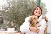 Miniature dachshund and smiling woman