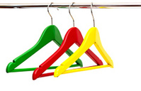 close up of colorful cloth hangers in row