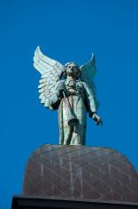 Bronze archangel on top of Notre-Dame-de-Bon-Secours Chapel
