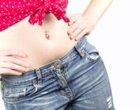 Woman's waistline with piercing.