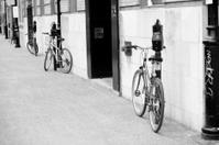 Four bicycles locked to parking meters