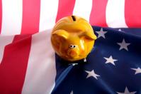 piggy bank on an American flag