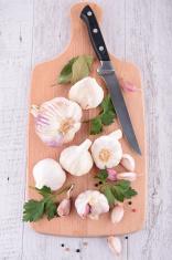 garlic bulb on plank