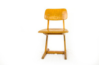 old used wooden school chair for the young pupils