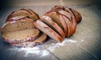 Fresh Tasty Bread on Woody Background