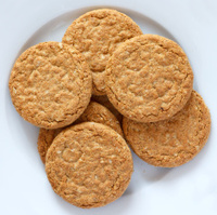 Plate of crispy golden oat biscuits taken from above