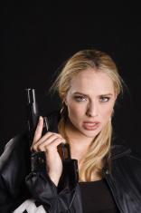 attractive blond with gun