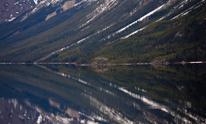 Mountain Side Mirrored in Lake Yukon Canada