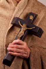 Hand holding Crucifix