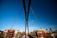 Delicate tubular and rope pedestrian bridge