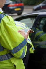 Police officer recording details