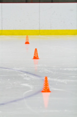 Pylons on the ice in an arena