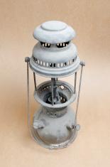 vintage kerosene lamp on paper background
