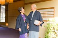 Senior couple in yukata coming to hot spring