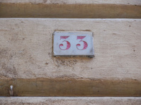 Red house number