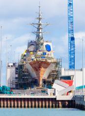 Destroyer under construction in a naval shipyard
