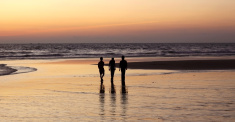 Three men on the beach