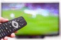 Watching football match on tv.