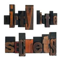 dirty little secrets, phrase written in vintage printing blocks
