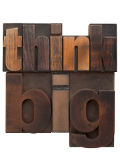 Think big, phrase written in vintage printing blocks