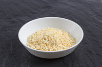 Chopped sweet almonds in a bowl on slate
