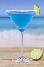 Blue Curacao cocktail on the beach
