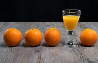 Glass of Orange juice with Fruits.
