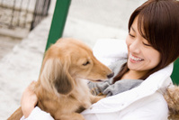 Woman holding Miniature dachshund