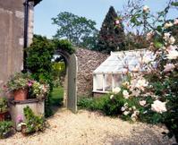 Open gate to garden beyond