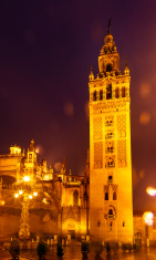 Giralda Bell Tower Seville Cathedral Rainy Night Car Trails Spai
