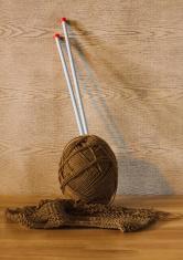 Ball of cotton & knitting needle