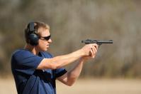 Teenager boy shooting pistol handgun