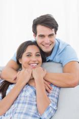 Portrait of a man embracing his partner