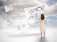 Businesswoman drawing on a floating paper