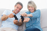 Couple playing video games on the sofa