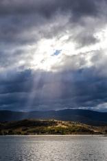 Sun Rays shining through clouds at Lake Jindabyne,