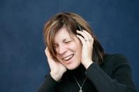 Woman singing with headphones