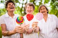 Senior women with lollipops
