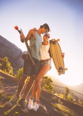 Cheerful skater couple on street