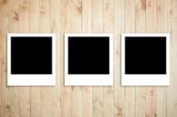Polaroid photo frame on wood plank background