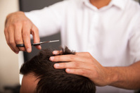 Closeup of a barber at work