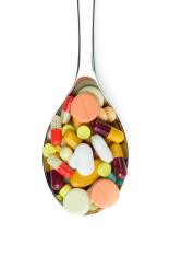 Spoon full of medicine pills