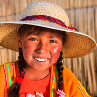 Little girl on Uros floating island, Lake Tititcaca, Peru