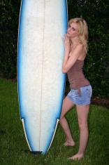 skinny model girl holding surfboard