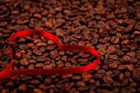 Coffe beans with ribbon heart