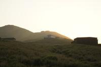 Mountain huts sunset