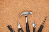 Set of tools on cork background