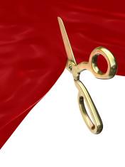 Scissor cutting red silk